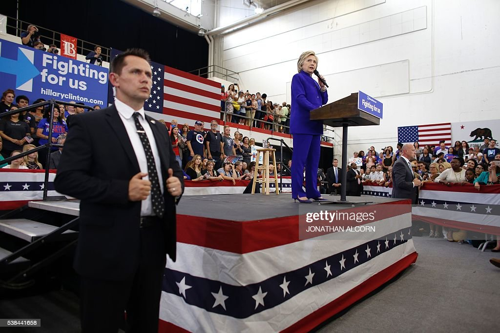 Democratic presidential candidate Hillary Clinton addresses a rally at Long Beach City College on the final day of California campaigning, June 6, 2016 in Long Beach, California. Hillary Clinton has received commitments from enough delegates to clinch the Democratic presidential nomination, according to the Associated Press and US networks, ensuring she will be the first woman to lead a major US party in the race for the White House. / AFP / JONATHAN