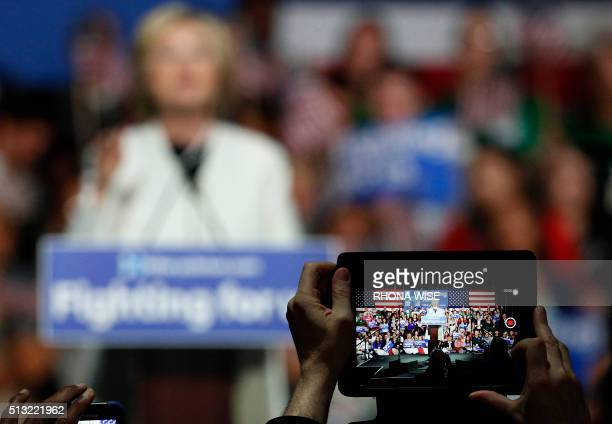 Democratic presidential candidate Hillary Clinton addresses her supporters at a rally during a campaign event on Super Tuesday in Miami on March 1...