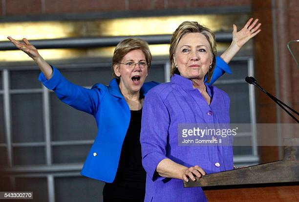 Democratic Presidential candidate Hillary Clinton addresses the crowd as US Sen Elizabeth Warren looks on during a campaign rally at the Cincinnati...