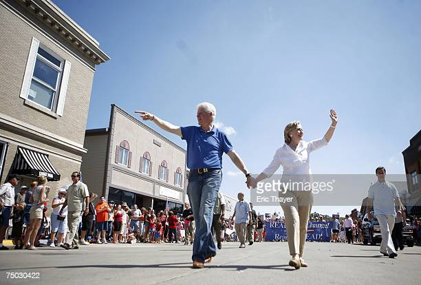 Democratic Presidential candidate Hillary Clinton and former President Bill Clinton walk in the the Clear Lake Independence Day Parade July 4 2007 in...