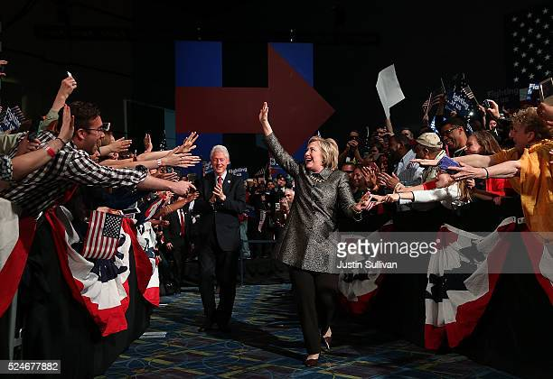 Democratic presidential candidate Hillary Clinton and former US president Bill Clinton greet supporters during a primary night gathering at the...