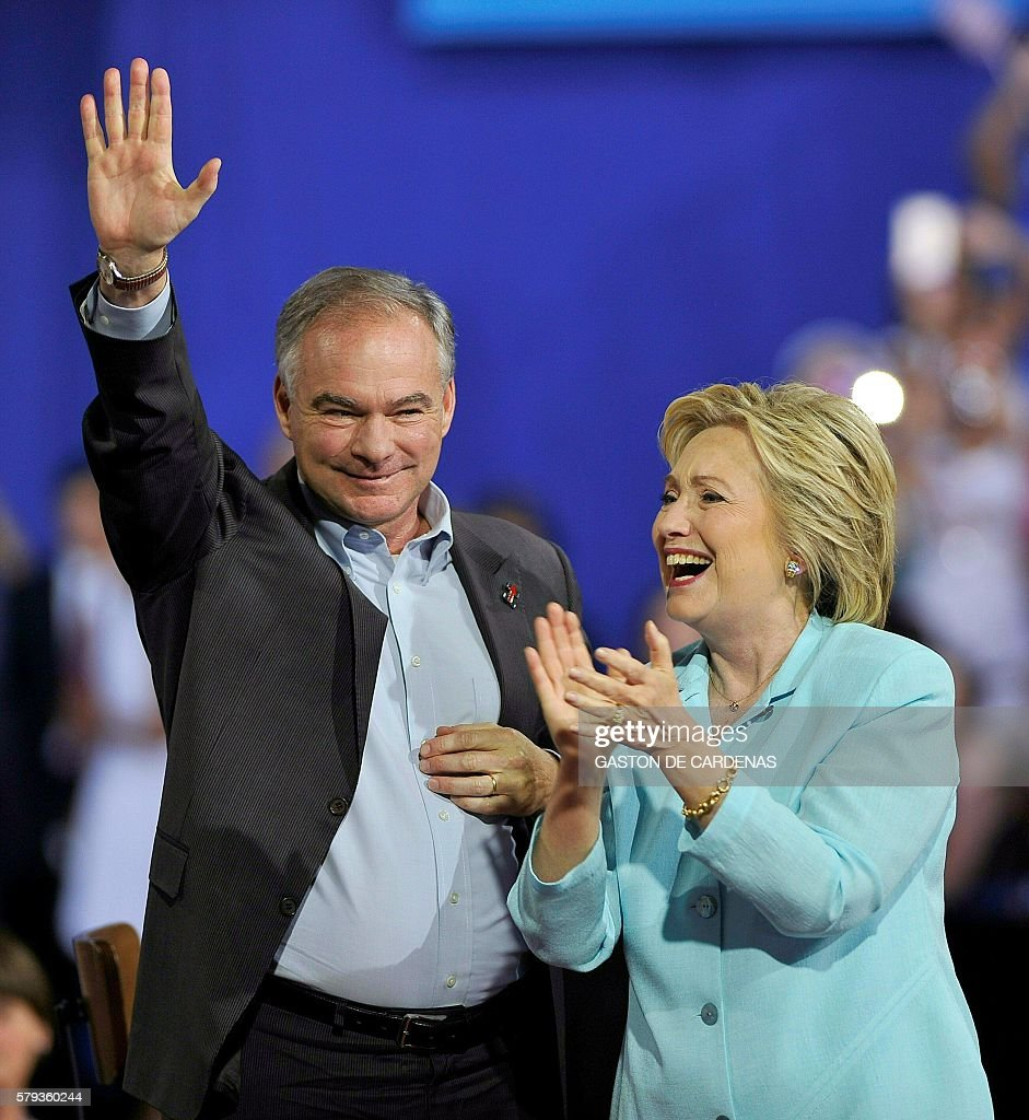 US Democratic Presidential candidate Hillary Clinton and running mate US Senator Tim Kaine arrive for a campaign rally at Florida International University in Miami on July 23, 2016. / AFP / Gaston De Cardenas