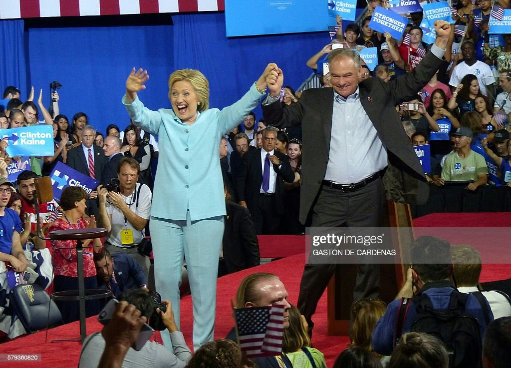 US Democratic Presidential candidate Hillary Clinton and running mate US Senator Tim Kaine greet supporters at a campaign rally at Florida International University in Miami on July 23, 2016. / AFP / Gaston De Cardenas
