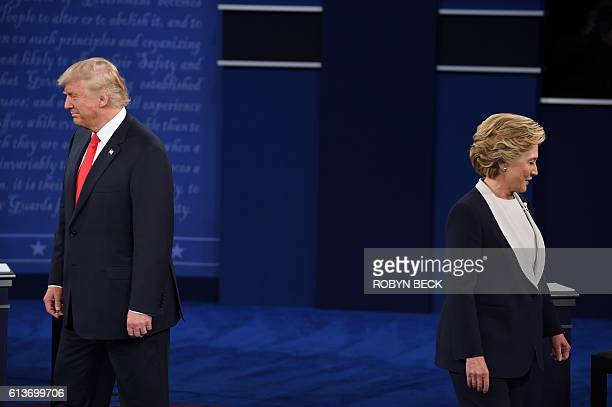 Democratic presidential candidate Hillary Clinton and US Republican presidential candidate Donald Trump arrive for the second presidential debate at...
