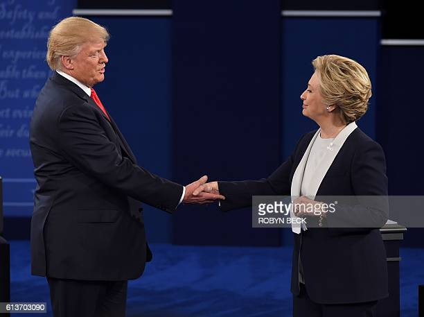 US Democratic presidential candidate Hillary Clinton and US Republican presidential candidate Donald Trump shake hands at the end of the second...