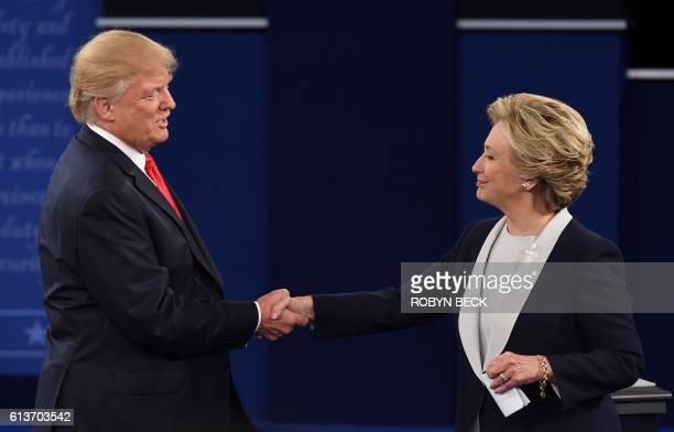 US Democratic presidential candidate Hillary Clinton and US Republican presidential candidate Donald Trump shakes hands after the second presidential...