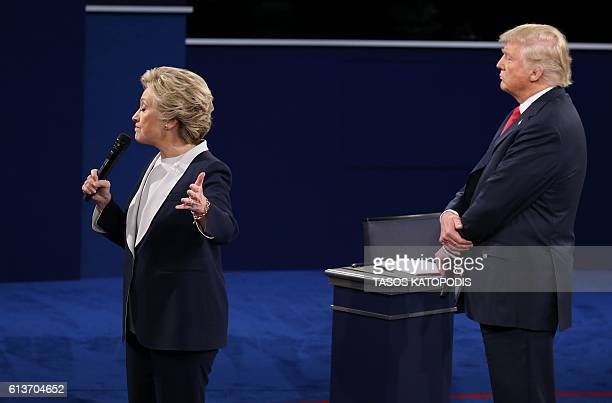 US Democratic presidential candidate Hillary Clinton and US Republican presidential candidate Donald Trump debate during the second presidential...