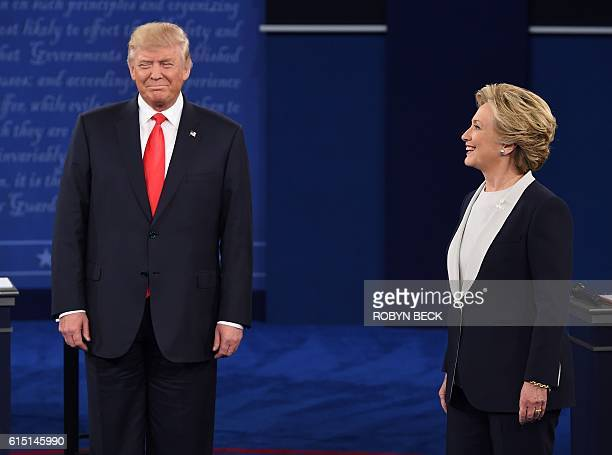 US Democratic presidential candidate Hillary Clinton and US Republican presidential candidate Donald Trump arrive for the second presidential debate...