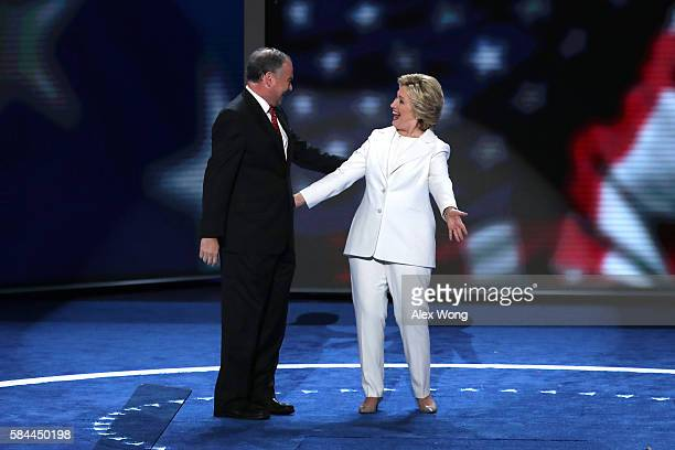 Democratic presidential candidate Hillary Clinton and US Vice President nominee Tim Kaine stand on stage after delivering a speech on the fourth day...