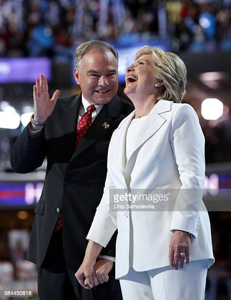 Democratic presidential candidate Hillary Clinton and US Vice President nominee Tim Kaine acknowledge the crowd at the end on the fourth day of the...