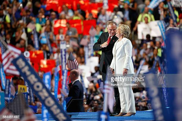 Democratic presidential candidate Hillary Clinton and US Vice President nominee Tim Kaine stand on stage at the end on the fourth day of the...