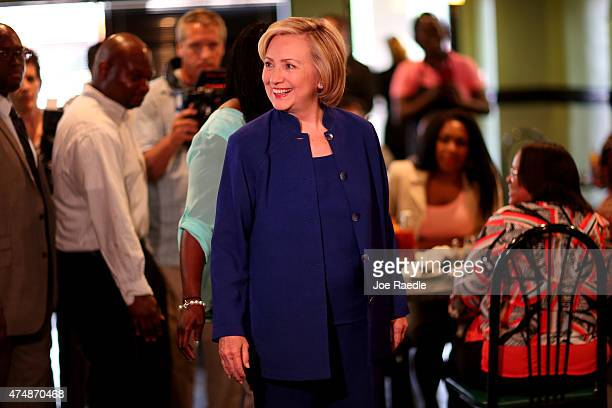 Democratic Presidential Candidate Hillary Clinton arrives for a campaign stop at the Kikis Chicken and Waffles restaurant on May 27 2015 in Columbia...