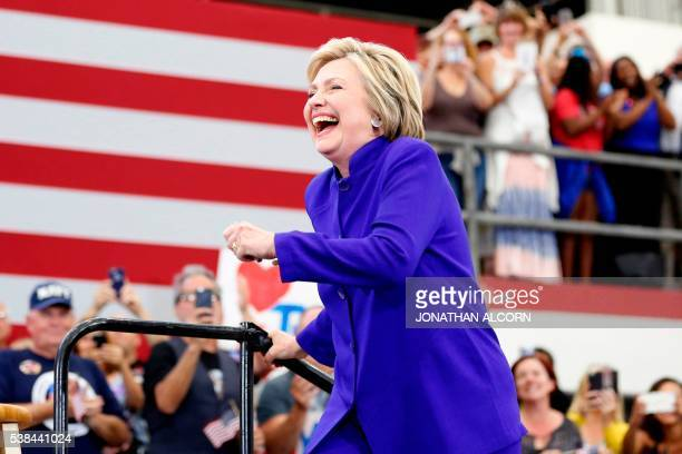 TOPSHOT Democratic presidential candidate Hillary Clinton arrives on stage for a rally at Long Beach City College on the final day of California...
