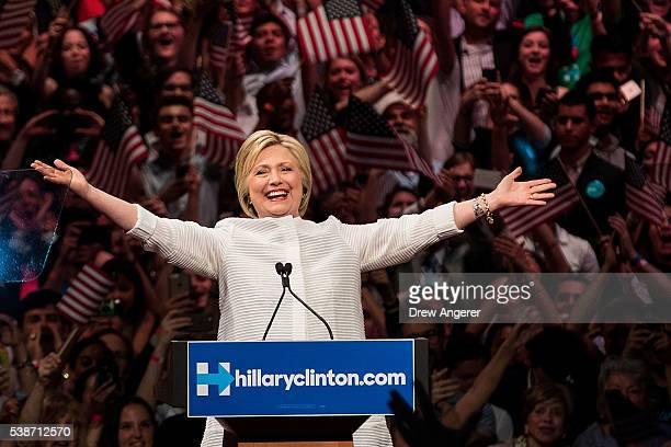 Democratic presidential candidate Hillary Clinton arrives onstage during a primary night rally at the Duggal Greenhouse in the Brooklyn Navy Yard...