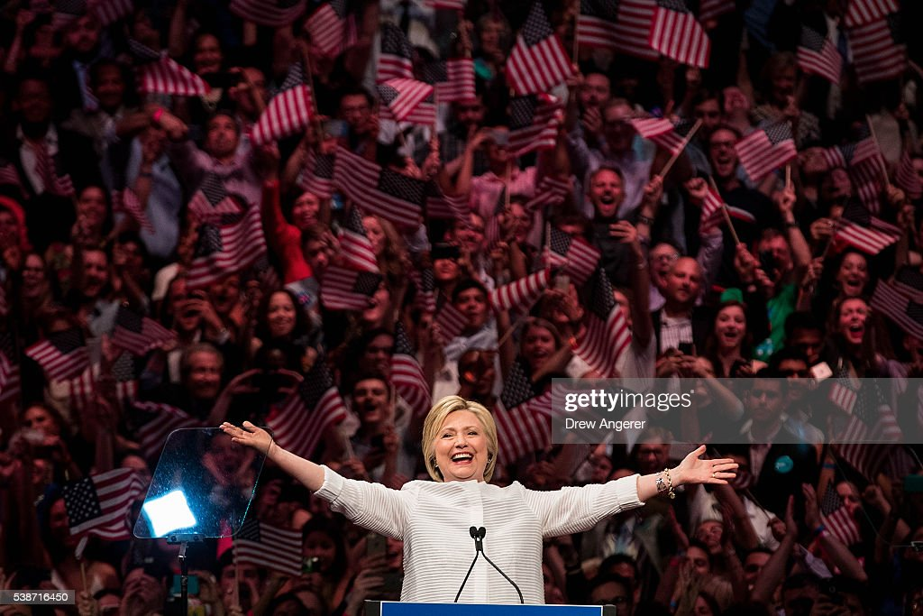 Democratic presidential candidate Hillary Clinton arrives onstage during a primary night rally at the Duggal Greenhouse in the Brooklyn Navy Yard, June 7, 2016 in the Brooklyn borough of New York City. Clinton has secured enough delegates and commitments from superdelegates to become the Democratic Party's presumptive presidential nominee. She will become the first woman in U.S. history to secure the presidential nomination of one of the country's two major political parties.