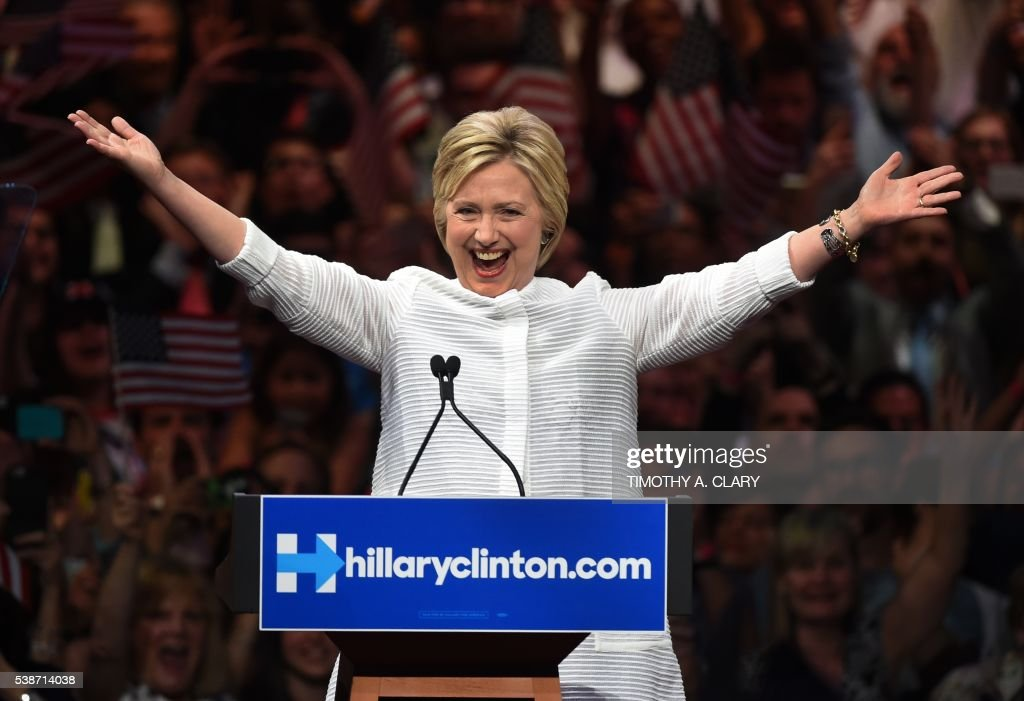 TOPSHOT - Democratic presidential candidate Hillary Clinton celebrates on stage during her primary night event at the Duggal Greenhouse, Brooklyn Navy Yard, June 7, 2016 in New York. Hillary Clinton hailed a historical 'milestone' for women as she claimed victory over rival Bernie Sanders in the Democratic White House nomination race. 'Thanks to you, we've reached a milestone,' she told cheering supporters at a rally in New York. 'The first time in our nation's history that a woman will be a major party's nominee.' A. CLARY