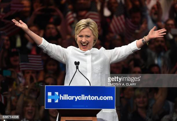TOPSHOT Democratic presidential candidate Hillary Clinton celebrates on stage during her primary night event at the Duggal Greenhouse Brooklyn Navy...