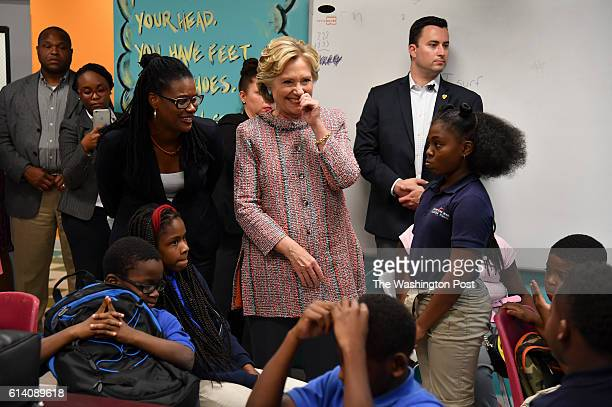 Democratic presidential candidate Hillary Clinton chuckles as she greets students while joined by NBA HallofFamer Alonzo Mourning and his wife Tracy...