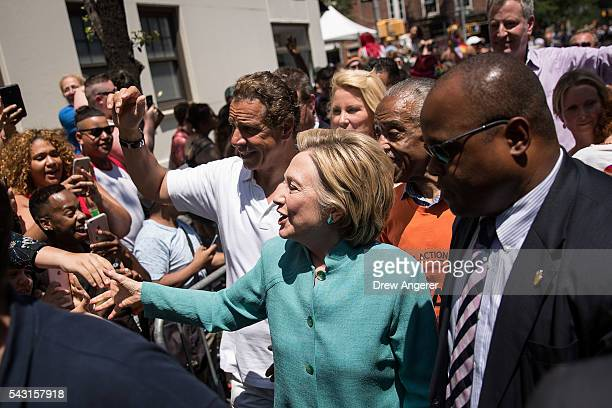 Democratic presidential candidate Hillary Clinton flanked by New York Governor Andrew Cuomo and Rev Al Sharpton attends the New York City Gay Pride...