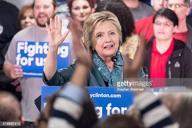 Democratic presidential candidate Hillary Clinton gestures during a rally with International Association of Machinists and Aerospace Workers...