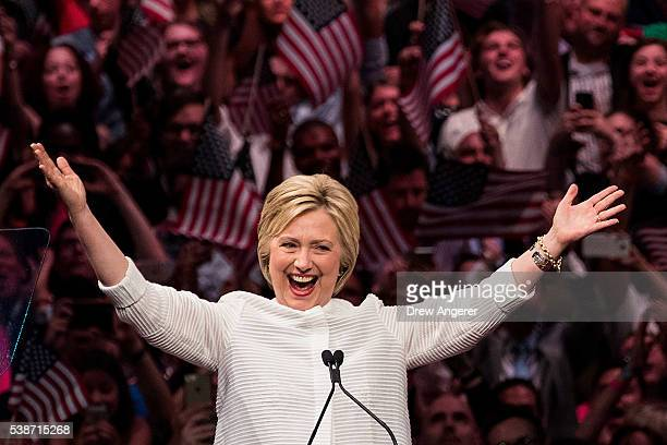 Democratic presidential candidate Hillary Clinton gestures to the crowd at the start of her remarks during a primary night rally at the Duggal...
