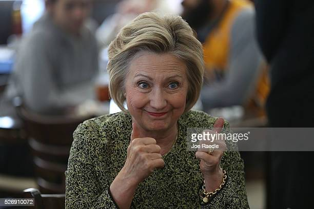 Democratic presidential candidate Hillary Clinton gives a thumbs up during a stop at the Lincoln Square pancake house as she campaign for votes on...
