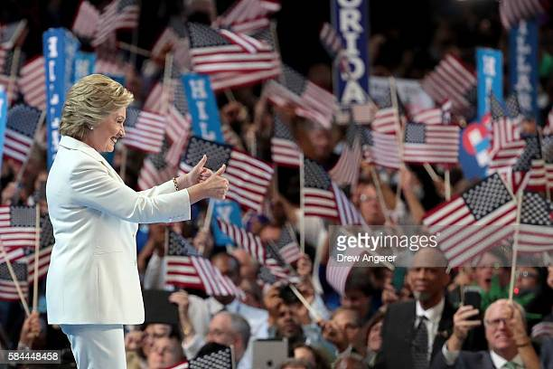 Democratic presidential candidate Hillary Clinton gives two thumbs up to the crowd as she arrives on stage during the fourth day of the Democratic...