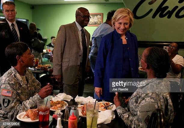 Democratic Presidential Candidate Hillary Clinton greets people as she visits the Kikis Chicken and Waffles restaurant on May 27 2015 in Columbia...