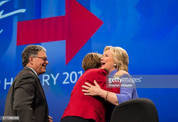Democratic Presidential candidate Hillary Clinton greets Sen Al Franken and Sen Amy Klobuchar at the Minneapolis Convention Center on July 18 2016 in...