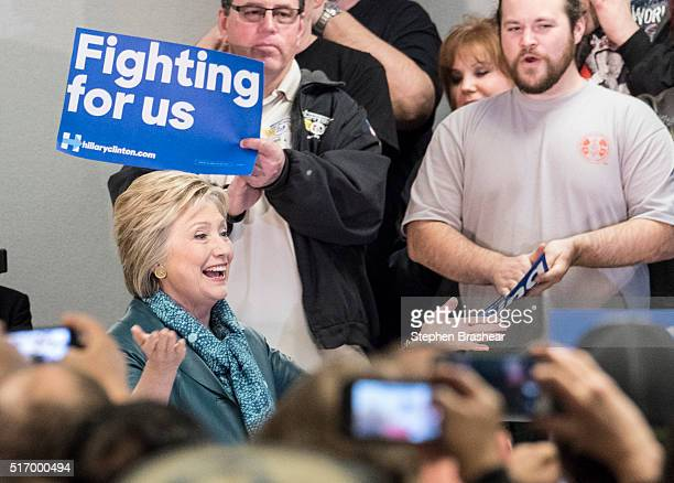 Democratic presidential candidate Hillary Clinton greets supporters during during a labor rally with International Association of Machinists and...