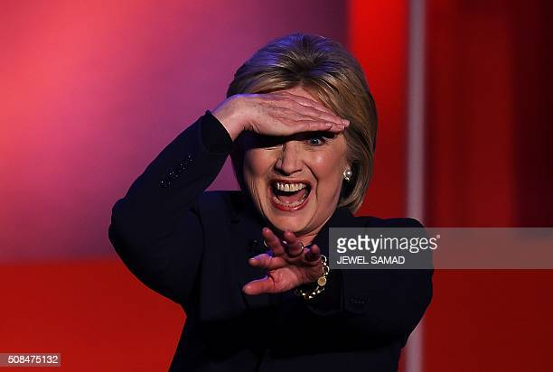 Democratic presidential candidate Hillary Clinton greets the audience after participating in the MSNBC Democratic Candidates Debate with Bernie...