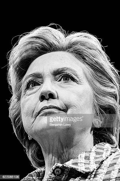 Democratic presidential candidate Hillary Clinton holds up a book as she speaks during a campaign rally at the Sunrise Theatre on September 30, 2016...