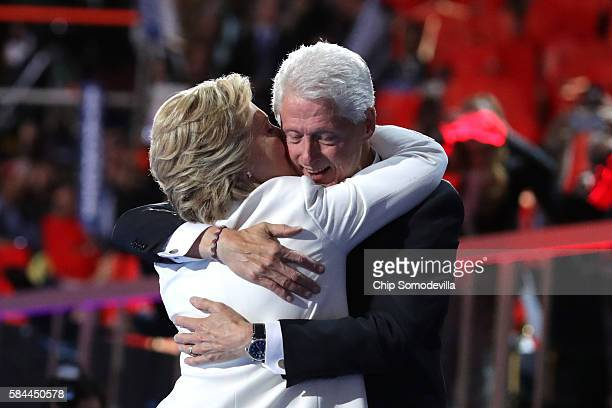 Democratic presidential candidate Hillary Clinton is embraced by her husband former US President Bill Clinton at the end of the fourth day of the...