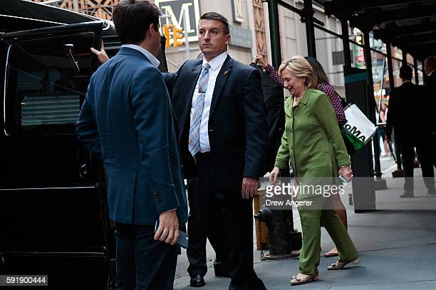Democratic presidential candidate Hillary Clinton is escorted to her motorcade by US Secret Service agents as she leaves a private meeting at the...