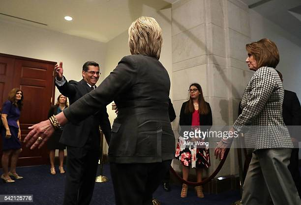 Democratic presidential candidate Hillary Clinton is greeted by House Democratic Caucus Chair Xavier Becerra as House Minority Leader Rep Nancy...