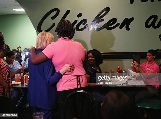 Democratic Presidential Candidate Hillary Clinton is hugged as she greets people during a campaign stop at the Kikis Chicken and Waffles restaurant...