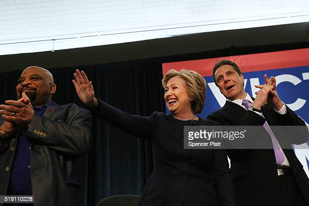 Democratic presidential candidate Hillary Clinton joins New York Governor Andrew Cuomo at a rally with after he signed a law that will gradually...