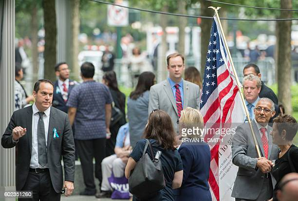 US Democratic presidential candidate Hillary Clinton leaves the 15th Anniversary of September 11 at the 9/11 Memorial and Museum on September 11 2016...