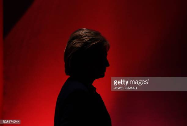 Democratic presidential candidate Hillary Clinton leaves the stage during a break as she participates in the MSNBC Democratic Candidates Debate with...