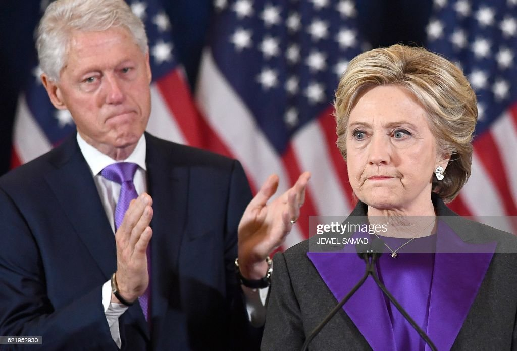 Democratic presidential candidate Hillary Clinton makes a concession speech after being defeated by Republican President-elect Donald Trump, as former President Bill Clinton looks on in New York on November 9, 2016. /
