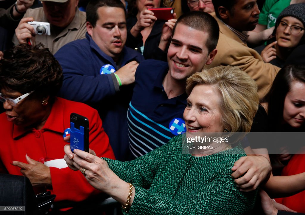 Democratic presidential candidate Hillary Clinton makes a selfie with her supporter at a grassroots event in Baltimore, Maryland on April 10, 2016. /