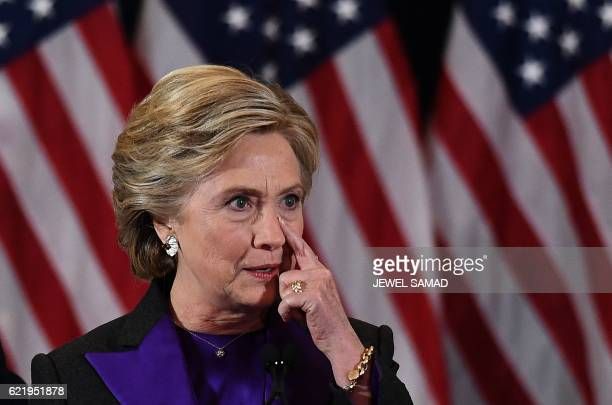 Democratic presidential candidate Hillary Clinton pauses as she makes a concession speech after being defeated by Republican Presidentelect Donald...