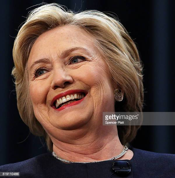 Democratic presidential candidate Hillary Clinton pauses at a rally with New York Governor Andrew Cuomo after he signed a law that will gradually...