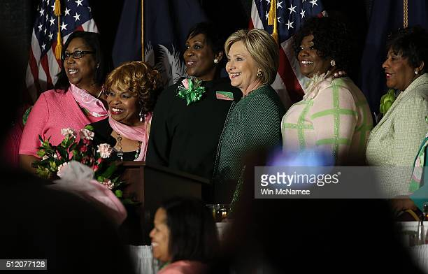 S Democratic presidential candidate Hillary Clinton poses for a photo with members of the Alpha Kappa Alpha Sorority during the Capitol Luncheon at...
