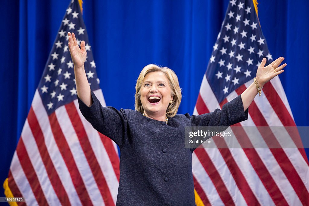 Democratic presidential candidate Hillary Clinton raises her arms stands on stage during the New Hampshire Democratic Party Convention at the Verizon Wireless Center on September 19, 2015 in Manchester, New Hampshire. Challenger for the democratic vote Sen. Bernie Sanders (I-VT) has been gaining ground on Clinton in Iowa and New Hampshire.