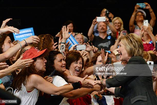 Democratic presidential candidate Hillary Clinton receives a warm reception from a capacity crowd at the Exposition Center of the North Carolina...