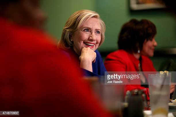 Democratic Presidential Candidate Hillary Clinton sits in on a round table discussion as she visits the Kikis Chicken and Waffles restaurant on May...