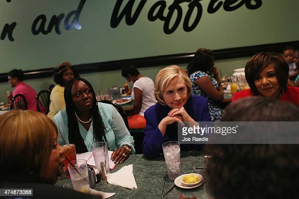 Democratic Presidential Candidate Hillary Clinton sits in on a round table discussion during a campaign stop at the Kikis Chicken and Waffles...