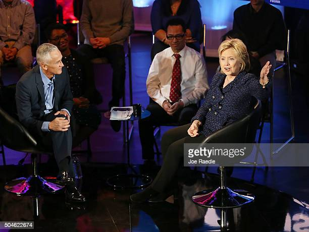 Democratic presidential candidate Hillary Clinton sits next to moderator Jorge Ramos during the the Iowa Brown and Black Forum sponsored by FUSION...