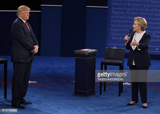 Democratic presidential candidate Hillary Clinton speaks as US Republican presidential candidate Donald Trump listens during the second presidential...